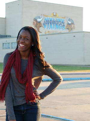 Tytiana Joseph stands in front of Airline High School, where she is a senior with a budding modeling career.