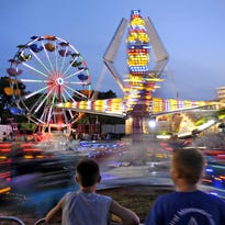 As the sun went down Aug. 5, 2014, the midway came to life with a personality of its own at the Benton County Fair.