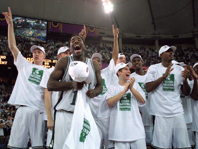 The Michigan State Spartans celebrates on the floor