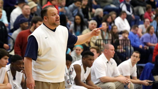 Siegel's head baskeball coach Ben Dotson coaches his team from the sidelines during the game against Lincoln County's on Tuesday Feb. 24, 2015, at Siegel.