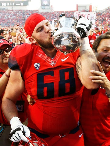 Arizona's Mickey Baucus kisses the Territorial Cup