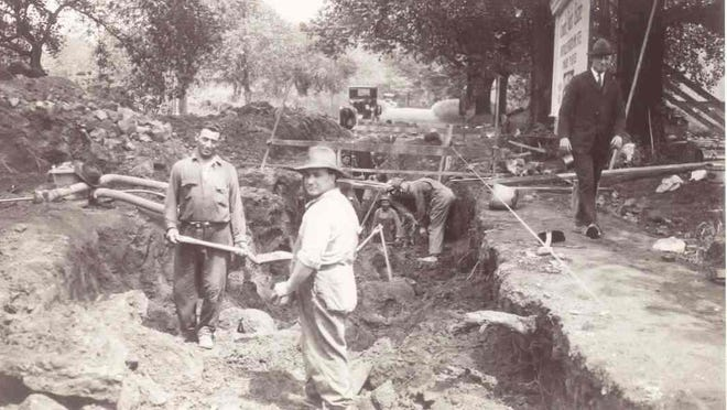 Workers dig up Council Rock Avenue, circa 1923. Improvements such as water and sewer services helped fuel suburban growth in the 1920s.