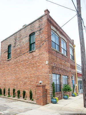 Matt and Chanell Gore along with two other couples converted this old building into an AirBnB on Wright Street in downtown Pensacola.  June 28, 2017.