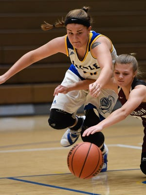 Castle's Mckendree Ward (33) and Henderson's Kaytlan Kemp (20) fight for a lose ball as the Castle Knights play the Henderson County Lady Colonels at Castle Tuesday, December 5, 2017.
