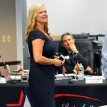 Lori Scott watches as the results come in Tuesday evening at Supervisor of Elections office in Viera .