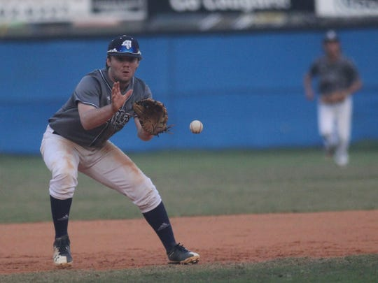 Maclay third baseman Taylor Smith fields a ground ball.