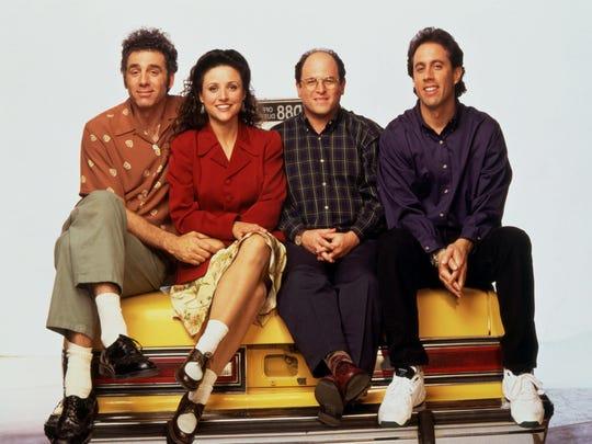From left, Michael Richards (Kramer), Julia Louis-Dreyfus