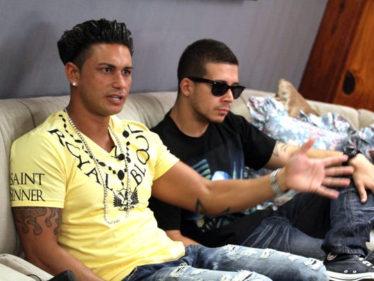 """Paul """"Pauly D"""" DelVecchio (left) and Vinny Guadagnino at the """"Jersey Shore"""" house in Seaside Heights in 2011."""