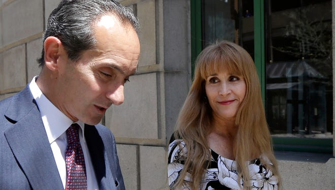 Therese Serignese and her attorney, Joseph Cammarata walk into U.S. District Court in Worcester, Mass., Thursday, May 7, 2015.