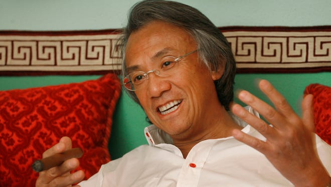 In this March 20, 2007 file photo, Hong Kong businessman David Tang gestures during an interview at his home in Hong Kong.