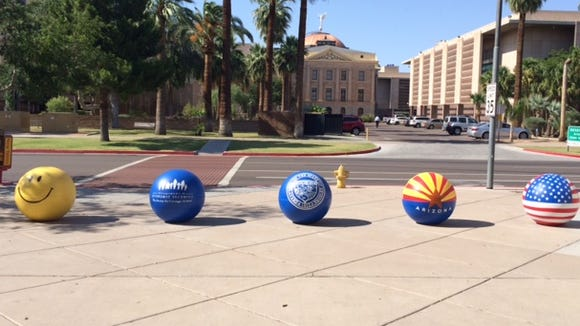 The Arizona Department of Economic Security sports brightly painted security barriers