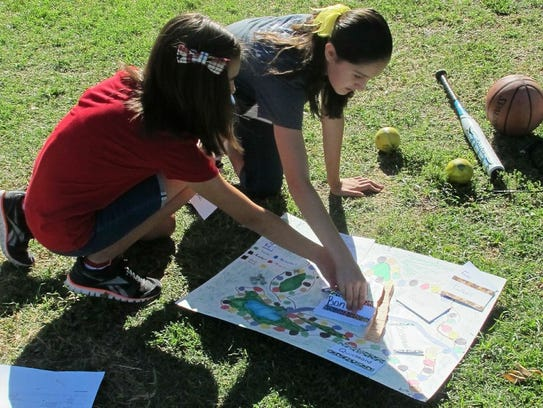 Students work on a hands-on activity associated with