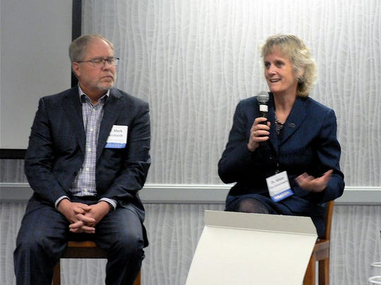 Dr. Mark Borcherdt, USDA microbiologist and Dr. Allison Van Eenennaam, U Cal Davis, animal genomics and biotechnology specialist answer questions after their presentations.
