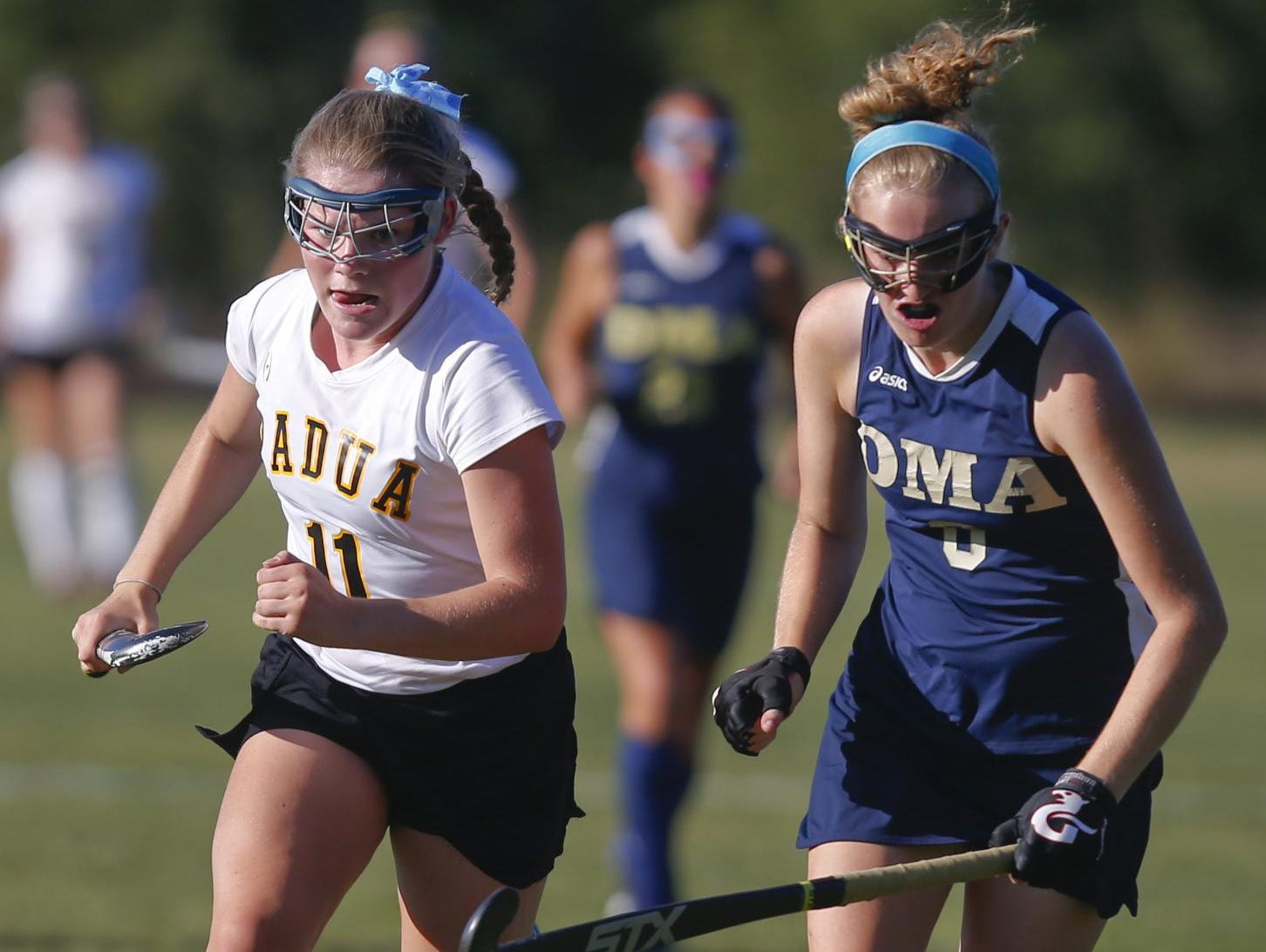 Padua's Jill Sherman (left) pursues the ball with Delaware Military Academy's Maya Sortino in Padua's 5-0 win at Forbes Field on Wednesday.