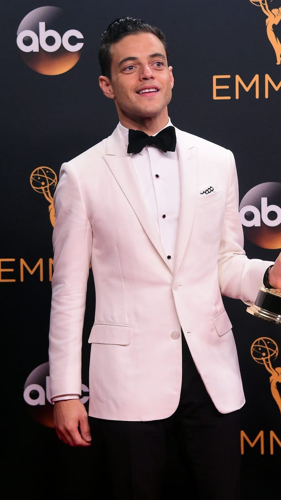 Rami Malek poses with the Emmy for outstanding lead
