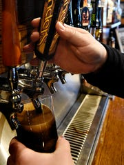 Owner Scott Eden pours a Founders Breakfast Stout at