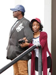 Monique Turner, 23, right, with Kevin Morris wait to