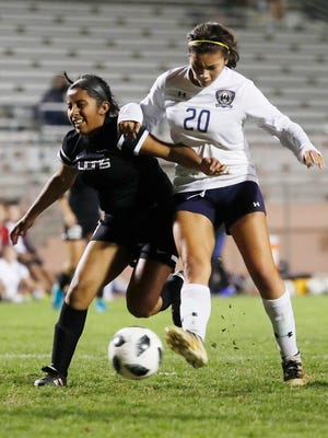 Monica Calderon, of La Quinta High School overpowers a defender from Cathedral City High School to score her hat-trick of the night at home.