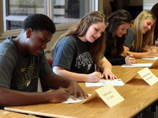 Crystal Chatham/The Desert SunLa Quinta High School athletes sign letters of intent for their chosen colleges on Wednesday during National Signing Day. From left: football player Charles Hays will attend University of California Davis; Annmarie Magnus will play volleyball at Kenyon College in Ohio; soccer player Aileen Galicia will attend New Mexico State; Kelli Finan plans to play softball at California State University, Long Beach; and volleyball player Julie Navarro will play at California State University, East Bay. La Quinta High School athletes sign letters of intent for their chosen colleges on Wednesday, February 4, 2015 during National Signing Day. From left: football player Charles Hays will attend University of California Davis; Annmarie Magnus will play volleyball at Kenyon College in Ohio; soccer player Aileen Galicia will attend New Mexico State; Kelli Finan plans to play softball at California State University, Long Beach; and volleyball player Julie Navarro will play at California State University, East Bay.