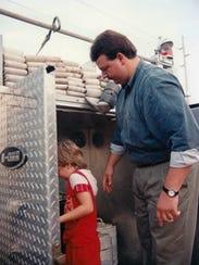 A young Austin Meador investigates a fire truck circa