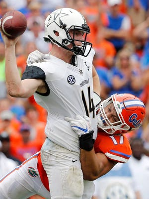 Florida Gators defensive lineman Jordan Sherit  pressures Vanderbilt Commodores quarterback Kyle Shurmur (14) during the second half at Ben Hill Griffin Stadium.