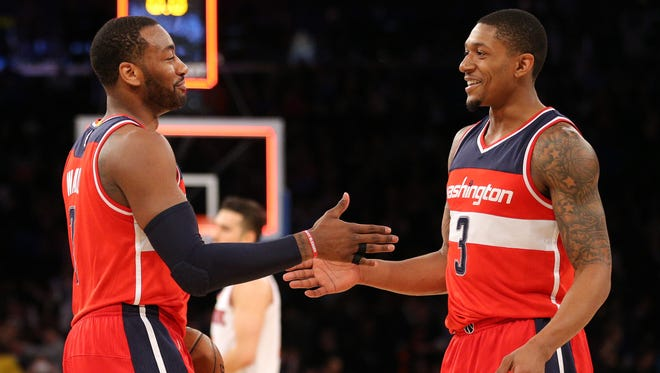 Washington Wizards point guard John Wall (2) and shooting guard Bradley Beal (3) celebrate after defeating the New York Knicks at Madison Square Garden.