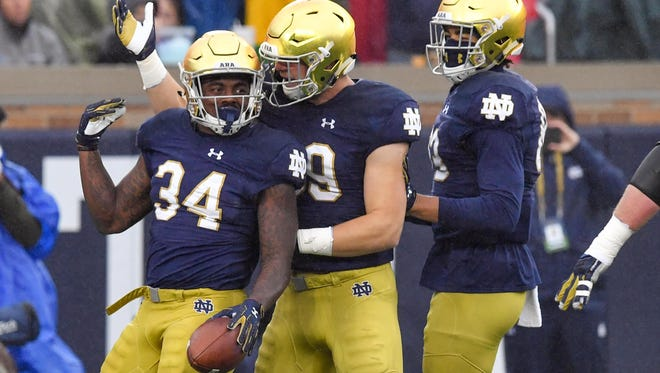 Nov 4, 2017; South Bend, IN, USA; Notre Dame Fighting Irish running back Tony Jones Jr. (34) celebrates after running for a touchdown in the second quarter against the Wake Forest Demon Deacons at Notre Dame Stadium. Mandatory Credit: Matt Cashore-USA TODAY Sports