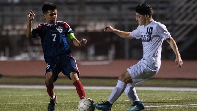 Veterans Memorial's Antonio Noyola and Calallen's Julien Nigou fight for the ball during their game Tuesday, Feb.6, 2018 at Wildcat Stadium.