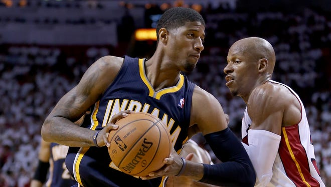 Pacers forward Paul George posts up on Miami guard Ray Allen in the Eastern Conference finals, May 26, 2014
