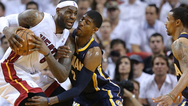 Miami Heats forward LeBron James defends the ball against Pacers forward Paul George Indiana Pacers play the Miami Heat in Game #4 of the NBA Eastern Conference Finals Monday, May 26, 2014, evening at American Airlines Arena in Miami FL.
