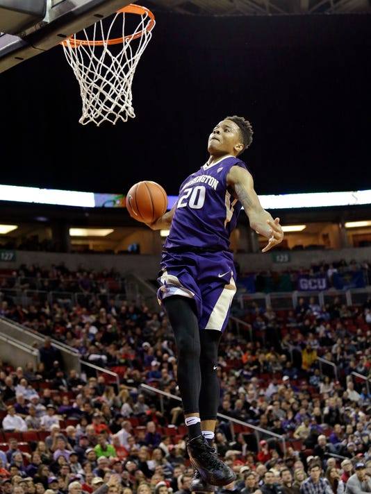 FILE - In this Dec. 22, 2016, file photo, Washington's Markelle Fultz winds-up to dunk against Seattle in an NCAA college basketball game, in Seattle. Fultz is the likely No. 1 pick in the NBA Draft on Thursday night, June 22. (AP Photo/Elaine Thompson, File)