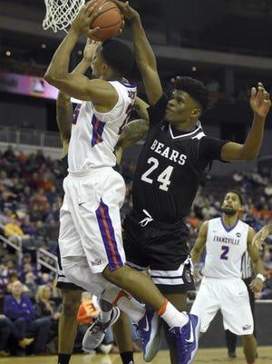 Duane Gibson of the University of Evansville is fouled while shooting by Alize Johnson of Missouri State during the first half of the game at the Ford Center in Evansville, Ind., Saturday.
