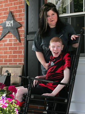 Leann VanAtta, of Coshocton, is considering whether to send her son Branson, 16, back to Hopewell School this fall following staffing changes there.
