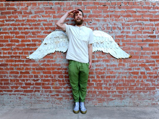 Hip-hop artist, masseuse, and generally-whimsical Abilenian Trevor Allen poses in front of a pair of angel wings mounted to the wall in the SODA Courtyard on Nov. 2, 2017. The building was renovated from the former Boy's Club at 817 S. 2nd St. and stands for South of Downtown Abilene.