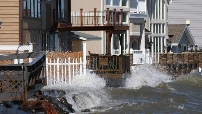 Some of the homes along Edgemere Drive near Beatty Beach are pounded by waves.