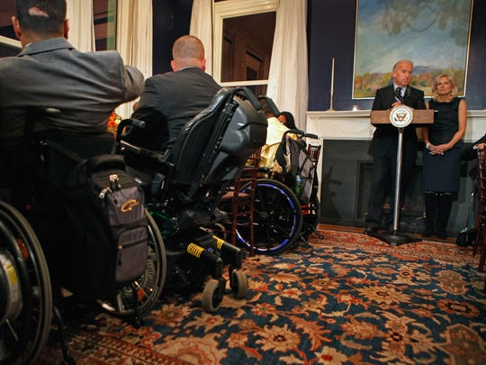 U.S. Vice President Joe Biden and his wife, Dr. Jill Biden, deliver brief remarks before sitting down for Thanksgiving dinner with sick and wounded members of the military and their families at the vice president's residence at the Naval Observatory November 22, 2010 in Washington, DC.