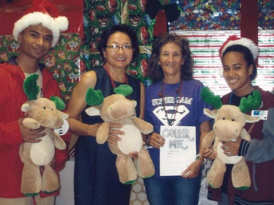 George Washington High School students in Tina Flores's art class designed coloring books and donated them to the Pediatrics Ward of Guam Memorial Hospital. Gifts were also donated to the patients. Picture from left: Ander Weito, Maria Perez GMH guest relations, Tina Flores, J-Liz Inocent, Rimiann Tataichy.
