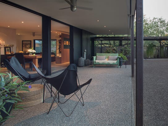 A 60-foot-long covered patio outside telescoping glass