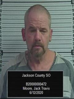 Jack Travis Moore, 55, was booked Friday evening into the Jackson County Jail in connection with felony drug possession.