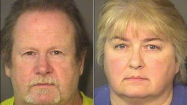 Dorian Lee Harper, left, and Wanda Sue Larson are charged with child abuse in North Carolina after an 11-year-old boy was found handcuffed to a porch with a dead chicken draped around his neck.