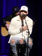 Kane Brown performs Tuesday, Feb. 6, 2018 at the CMA Theater in Nashville, Tenn.