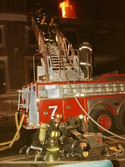 David W. Smerage, Indianapolis firefighter is treated after his foot became pinned in the ladders retracting sections.