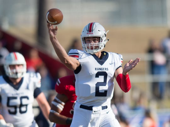Northwest Mississippi quarterback Jack Abraham throws