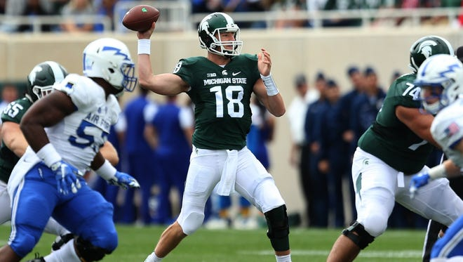 Michigan State's Connor Cook passes against  Air Force during first half action on Saturday, September19, 2015 at Spartan Stadium in East Lansing Michigan.