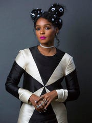 """This Dec. 20, 2016 photo shows singer-actress Janelle Monae, who stars in the Oscar-nominated film, """"Hidden Figures,"""" in NewYork."""