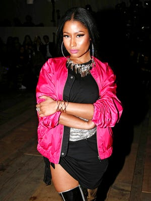 FILE - In this Wednesday, March 1, 2017 file photo, singer Nicki Minaj arrives to attend the H&M Fall-Winter 2017-2018 ready to wear fashion collection presented in Paris. On Friday, March 10, 2017, Minaj responded to Remy Ma's harsh diss track in a new song featuring her label mates Drake and Lil Wayne.