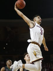 ASU's Sam Cunliffe (3) goes up for a dunk against Portland