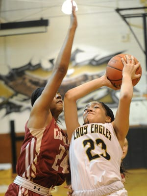 Abilene High's Destiny Gallentine (23) drives against Keller Central's Lauryn Daigle.The Lady Eagles beat Central 63-49 in the District 3-6A game Tuesday, Jan. 3, 2017 at Eagle Gym.
