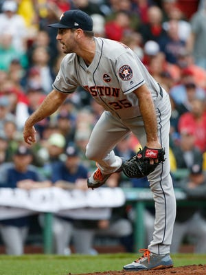 Houston Astros relief pitcher Justin Verlander follows through during the fifth inning in Game 4 of baseball's American League Division Series against the Boston Red Sox, Monday, Oct. 9, 2017, in Boston.