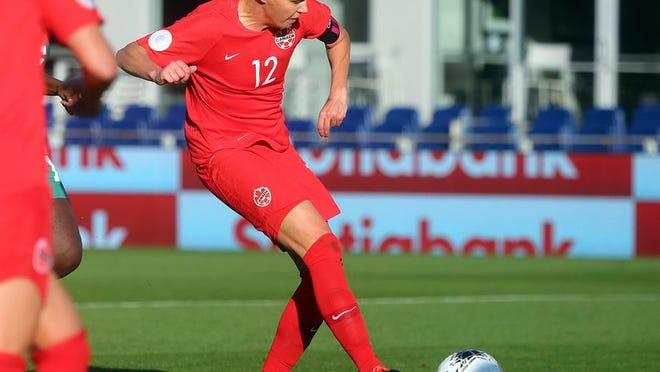 Canada's Christine Sinclair scores against St. Kitts and Nevis during a CONCACAF women's Olympic qualifying soccer match Wednesday, Jan. 29, 2020, in Edinburg, Texas. Sinclair scored her 184th goal, passing Abby Wambach for first place.